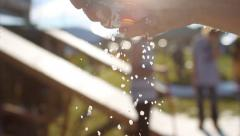 Dropping salt out of hand in slow motion - 2 clips Stock Footage