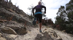 Women running up rocky trail colorado - stock footage