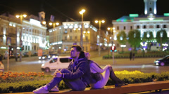 The couple at the night city square. HD 1080p Stock Footage