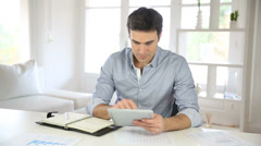 Businessman working from home with tablet Stock Footage