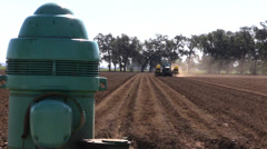 California Agriculture,  drip irrigation installation, pump - stock footage