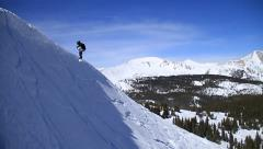 Snowboarding off cornice colorado - stock footage