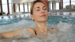 Woman enjoying bath in spa center Stock Footage