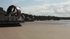 Military hovercrafts on beach Stock Footage