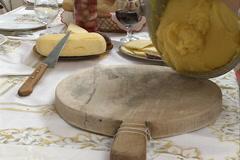 Senior woman pours polenta on the table. Stock Footage