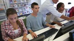 Students in computers' laboratory with teacher Stock Footage