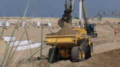 Loading a sand truck + pan boulevard at the Dutch North Sea coast Stock Footage