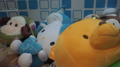 Toys, winnie pooh, mickey mouse and teddy bear inside claw machine Stock Footage