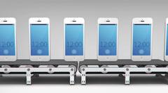 Phones on conveyor Stock Footage