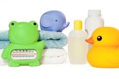 Baby bath accessories isolated: towels, toys, thermometer and bottles with co Stock Photos