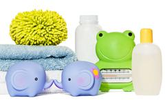 Baby bath accessories isolated: towels, toys, sponge, thermometer and bottles Stock Photos