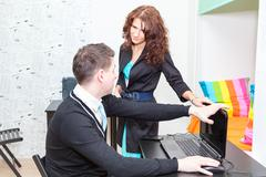 Anger woman closing laptop for stopping playing game online Stock Photos