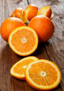 Group of oranges on a wooden table Stock Photos