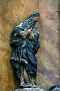 Blessed Virgin Mary under the cross - stock photo