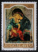 Christmas stamp printed in Yugoslavia shows Madonna and Child - stock photo