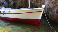 Small boat anchored in the shallow sea, Stock Video footage, HD 1080p, 25 fps - stock footage