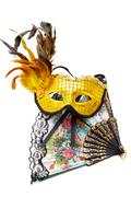 masquerade  mask and  fan isolated on a white background - stock photo