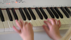 Girl playing piano hands only Stock Footage