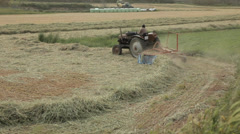Tractors Working on a Field agricultural machinery on organic farm wheat barley Stock Footage