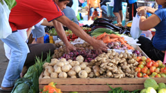 People buying and selling vegetables and fruit at market. Dumaguete,Philippines. Stock Footage