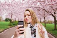Stock Photo of attractive young woman posing for selfie