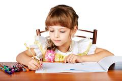 the little girl draws in an album felt-tip pens - stock photo