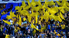 Soccer Fans with Flags Closeup and slow motion Stock Footage