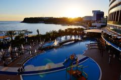 The swimming pool and beach during sunset antalya, turkey Stock Photos