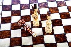 chessboard with decorative chessmen - stock photo