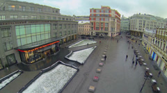 Citizens walk by square near Central Department Store Stock Footage