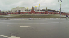 Traffic  near Kremlin complex with Ivan Great bell towe Stock Footage