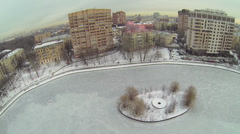 Cityscape with houses around Egersky pond at winter Stock Footage