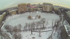 Egersky pond among houses at winter day in Moscow. Aerial view Stock Footage