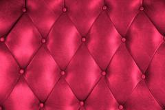 luxury upholstery leather button chair texture in magenta - stock photo