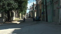 Man cleaning street in havanna Stock Footage