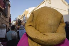 Group of costaleros during a procession of holy week, andalucia, spain Stock Photos