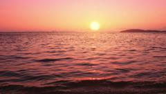 Early morning sunrise panoramic view on sea coast. Sun and horizon on red sky Stock Footage