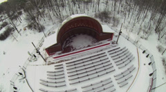 Small outdoor amphitheater in winter snowy park. Aerial view Stock Footage