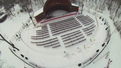 Snowy park with small outdoor amphitheater at winter day Stock Footage