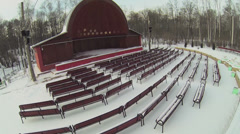 Stage with hemispherical roof and rows of benches in winter Stock Footage