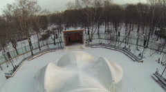 Small outdoor stage and dancing ground in winter snowy park Stock Footage
