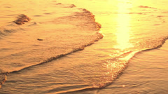 Nature background. Ocean beach waves on beach at sunset. Evening beautiful video Stock Footage