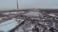 Cityscape with street traffic near Ostankinskaya TV tower Stock Footage