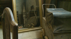 Reflection in mirror, a vintage pram Stock Footage
