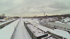 Last wagons of freight which rides by city outskirts Stock Footage