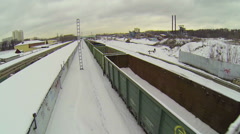 Snow lies in wagons of freight which rides by city outskirts Stock Footage