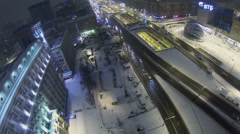 Traffic on Leningrad prospect near edifice at winter night Stock Footage
