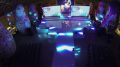 Stage and displays in concert hall with people at trade center Stock Footage