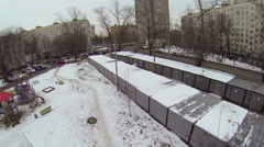 Playground on yard near garages and street with tramway line Stock Footage