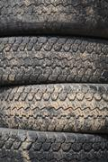 Pile of old recycle rubber truck tires Stock Photos